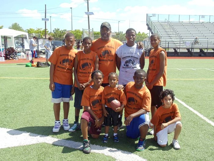 "GIVING BACK – College Football Hall of Famer Rich Glover (back row, center) conducted his 11th Annual ""All Access to Life Foundation"" free football camp at Caven Point Cochrane Field last week. Front row, from left, are Tysaan White, Tyler White, Hasan Dominick and Ivan Zuniga. Back row, from left, are Daivan Lee, Kasaan Brevard, Glover, Tsulu Scrivens and Devin Johnson."